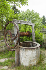 Old abandoned dry rusty draw well. Summer drought. Water crisis