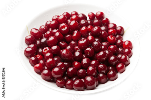 sour cherries on a plate, isolated on white