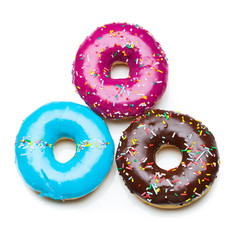 three color donuts, isolated on white
