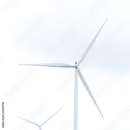 wind turbine in wind farm against cloudy sky