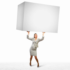 Businesswoman holding heavy cube
