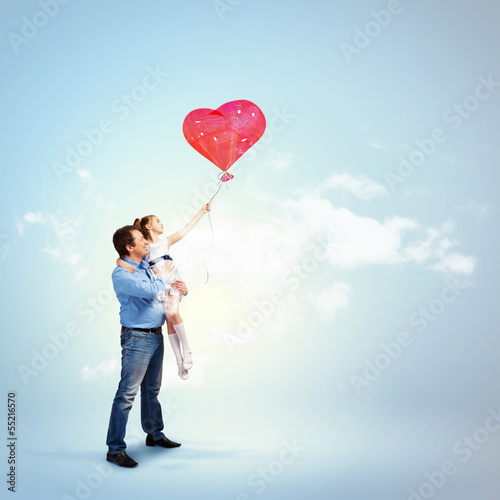 Father holding his daughter and a red heart