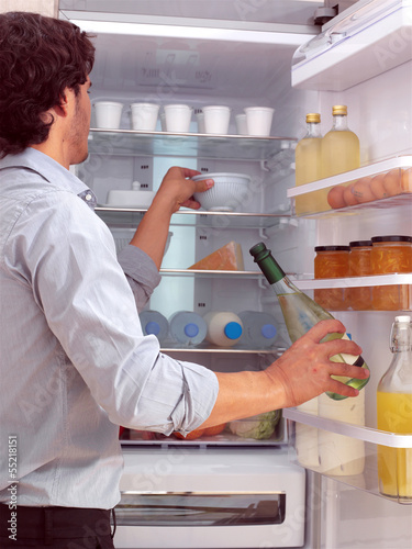 Man standing near freezer l