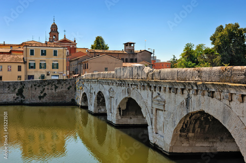 Historical roman Tiberius' bridge over Marecchia river in Rimini