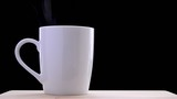 White Cup of Tea or Coffee on the Black Background
