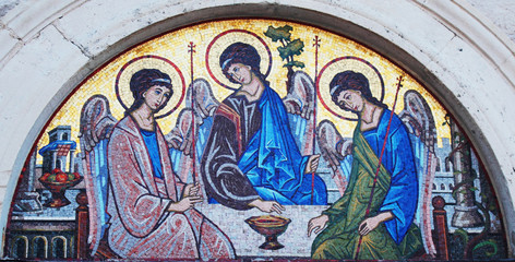Artistic mosaic icon of three angels (Holy Trinity)
