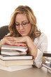 woman asleep on stack of books