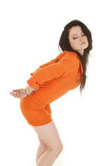 Woman orange prison handcuffs behind butt out