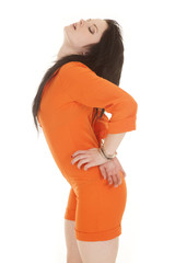 Woman orange prison handcuffs behind head back