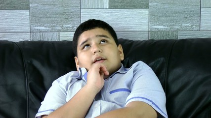 Boy thinking at home