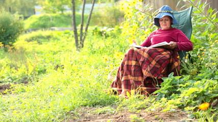 Adorable senior woman reading a book
