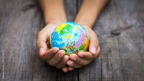 Person holding a globe - 55224559