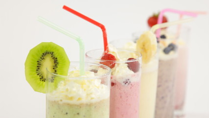 assorted milk cocktails with fruits and berries closeup