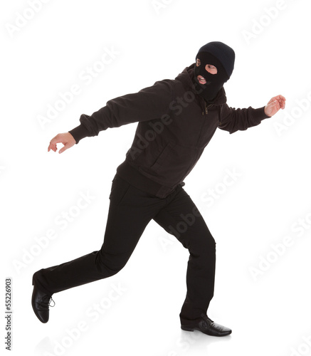 Bandit In Black Mask Running Away