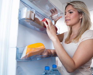 Woman Searching In Refrigerator