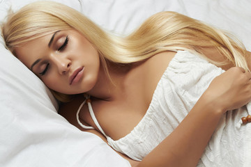 sleeping beautiful blond woman. beauty girl. white dress