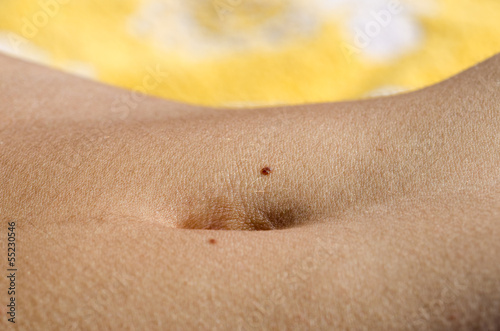 Girl Bellybutton With Two Moles Closeup