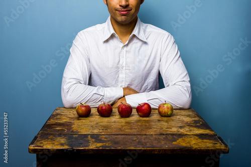 Man with five apples