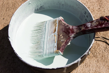 Paint brush white  paint can