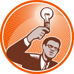 Businessman Holding Lightbulb Woodcut