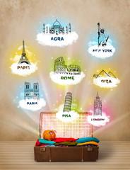 Tourist suitcase with famous landmarks around the world