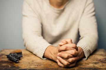 Praying man with a gun