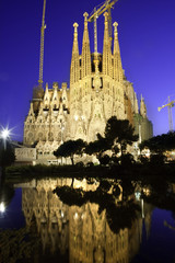 Sagrada Familia at dusk, with beautiful reflections in a lake.