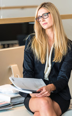 Businesswoman In Office Working On A Document