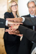 Teamwork - business people with joint hands in the office