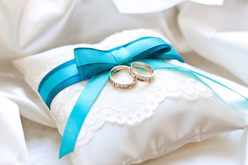 wedding rings on a cushion
