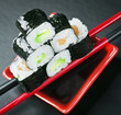 Pyramid of rolls on sticks for sushi. Focus on the top roll