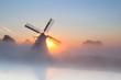 Dutch windmill in dense fog