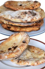 Freshly cooked Naan bread © Arena Photo UK