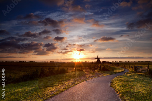 warm sunbeams by Dutch windmill
