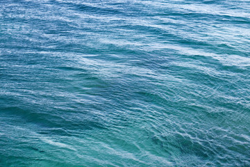 Bright Adriatic sea water background texture