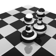Sliced black and white pawns on chessboard