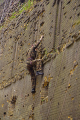 Young climber in khaki
