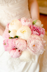 Wedding bouquet. Bride with bouquet, closeup