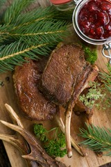 Venison chops on wooden ground