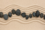 Black stones on the sand