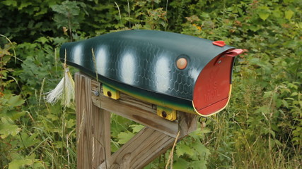 Fishing lure mailbox. Note. Front of mailbox says US Mail.