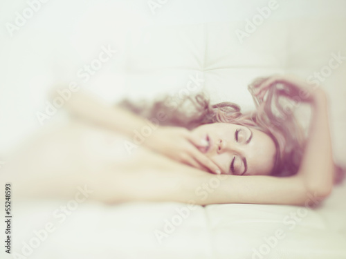 Leinwanddruck Bild Sensual woman in bed