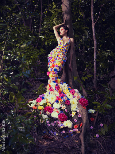 Beautiful lady in dress of flowers