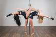 flexible dancer doing difficult acrobatic tricks with pole