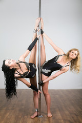 Two young dancer doing acrobatic tricks and do splits