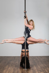 Two young girls doing difficult acrobatic tricks and do splits