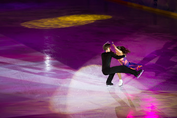 Beautiful pair perform an iceskating shot