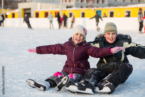 Brother and sister fell while skating and having fun on ice