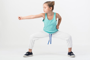 girl is standing in fighting stance with outstretched fist