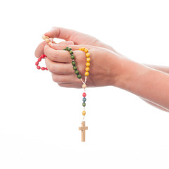 women hands hold the rosary - isolated